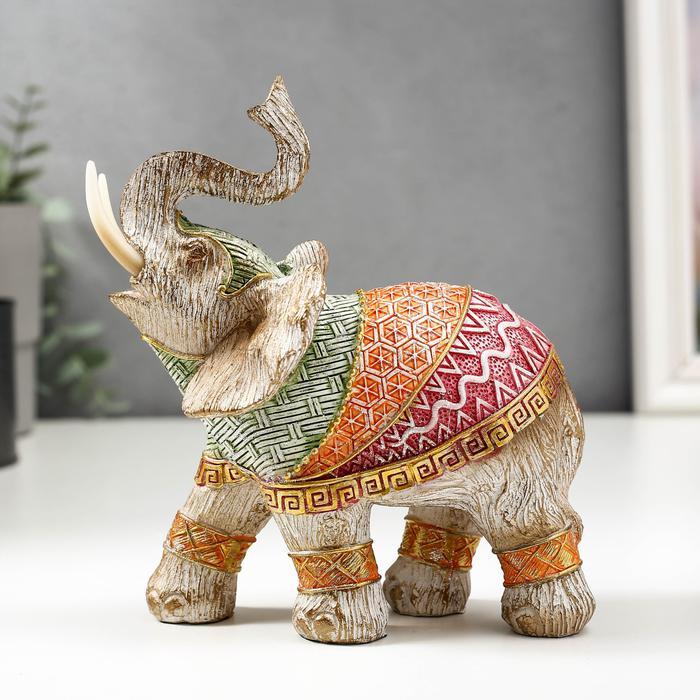Слон в разноцветной попоне с рисунками 56072